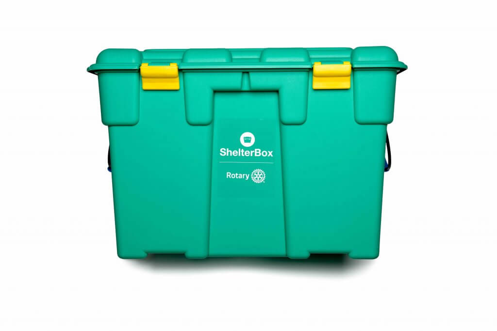 Green ShelterBox containing emergency shelter and essential aid items