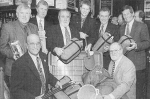 Rotarians gathered around a box