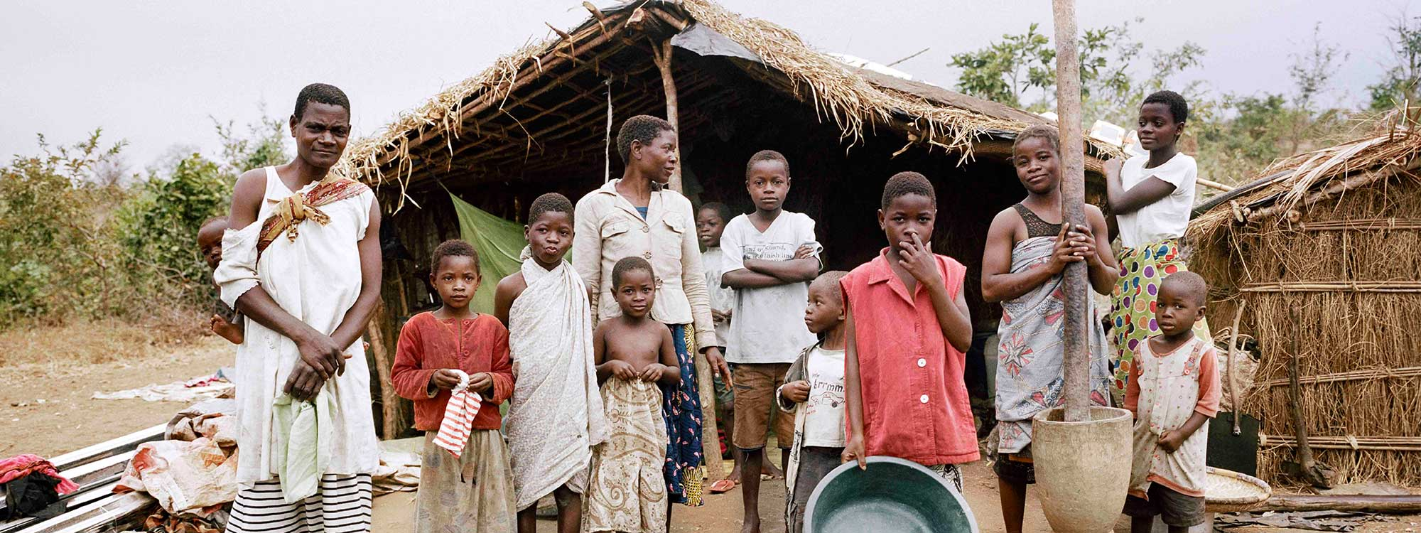 family in malawi outside their home