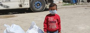 syrian boy in facemask