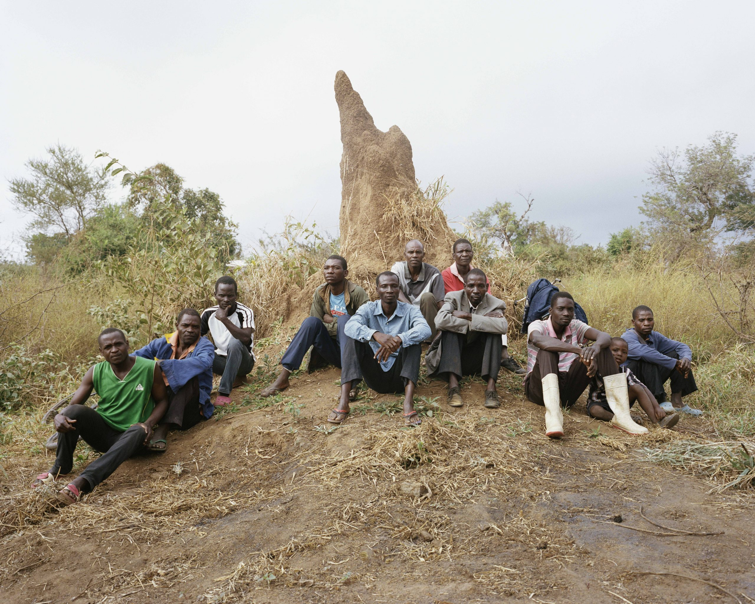 a group of men sat on a small hill