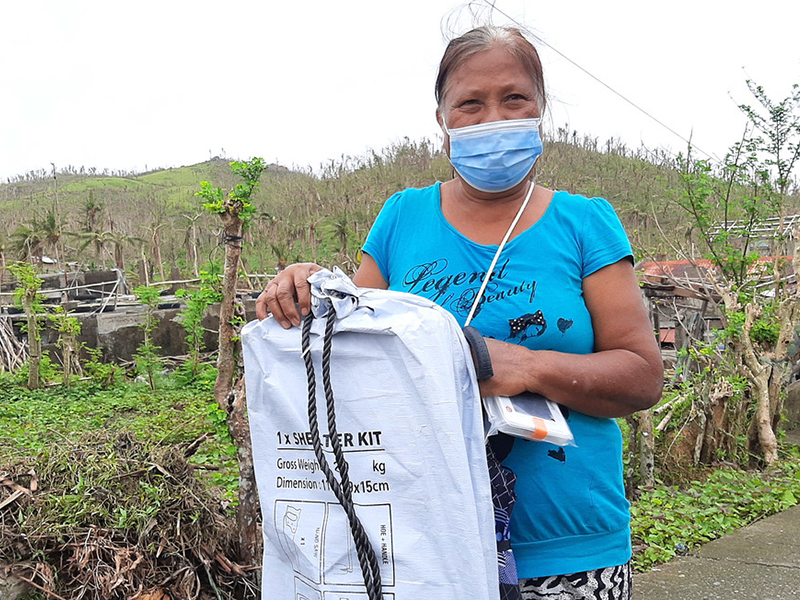 Local woman happy to receive her ShelterKit and solar light
