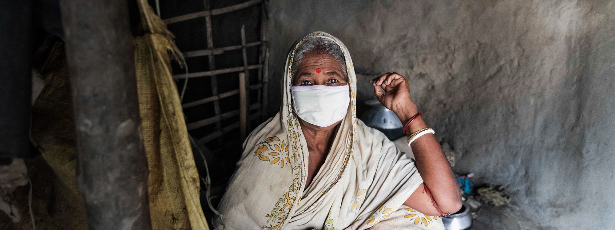 woman wearing facemask in india