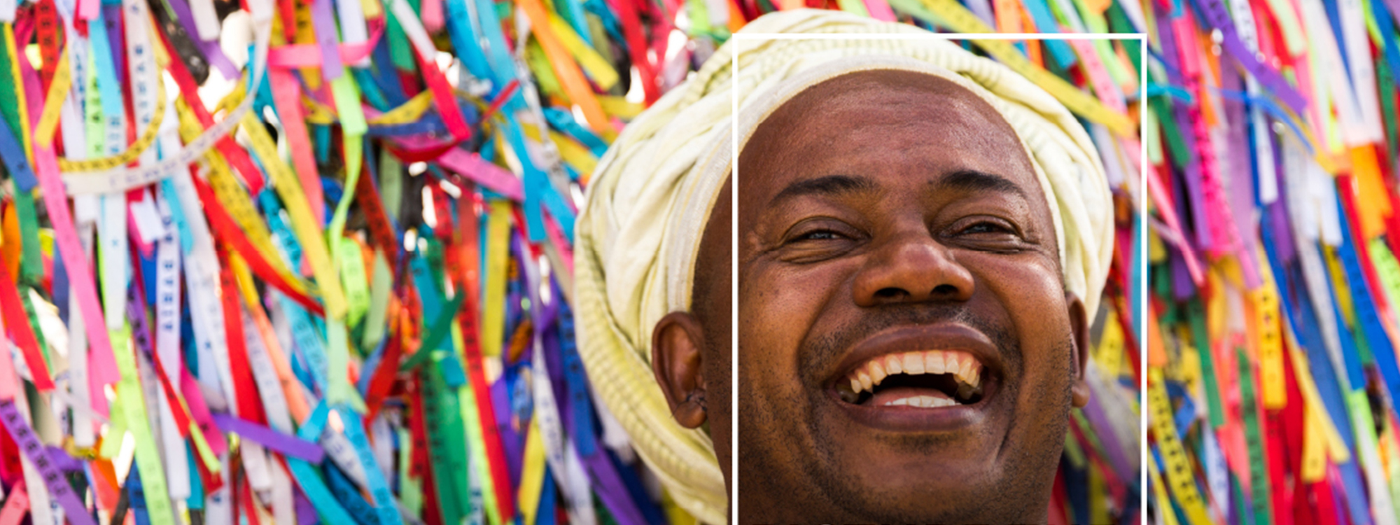 Man smiling with colourful background