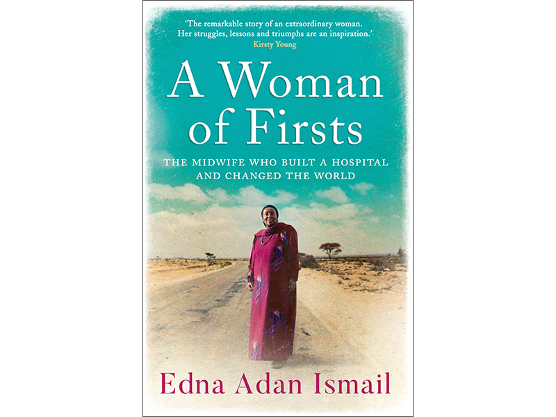 Woman of Firsts Book cover depicting a woman standing on a desert roadway
