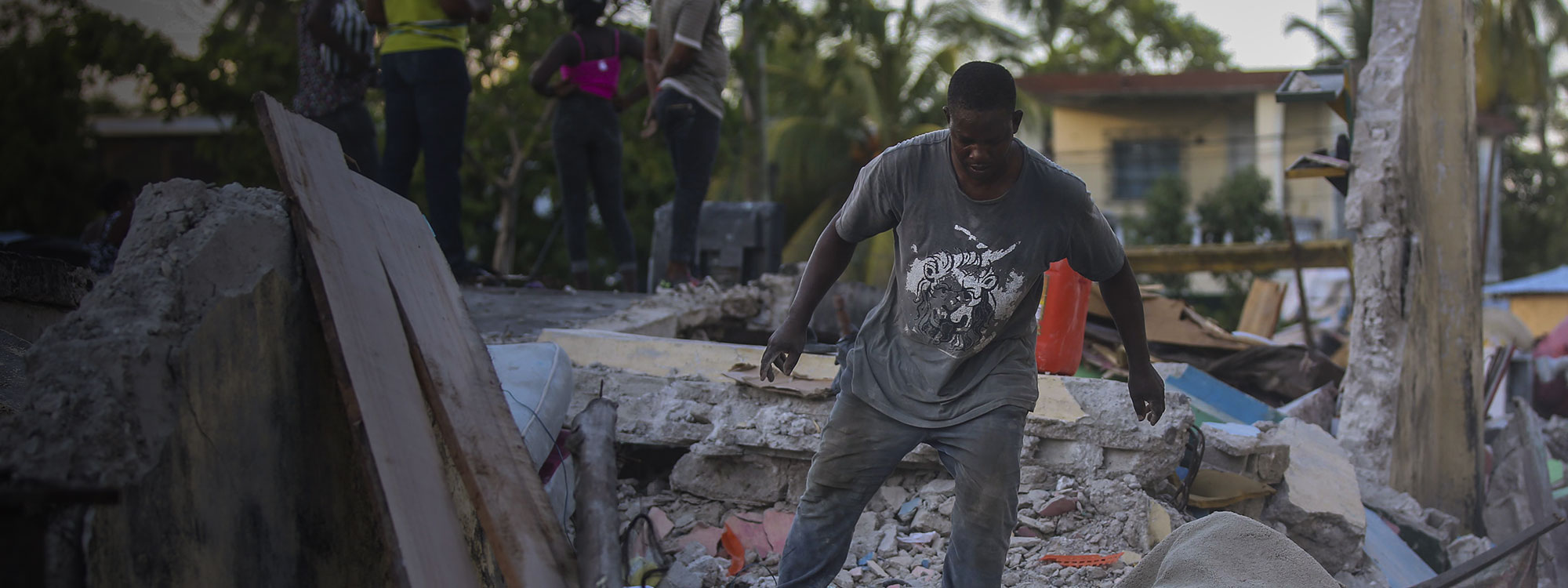 Earthquake, Les Cayes, Haiti 14-Aug-2021. Man tries to recover belongings from his home destroyed by the earthquake. Joseph Odelyn AP Shutterstock