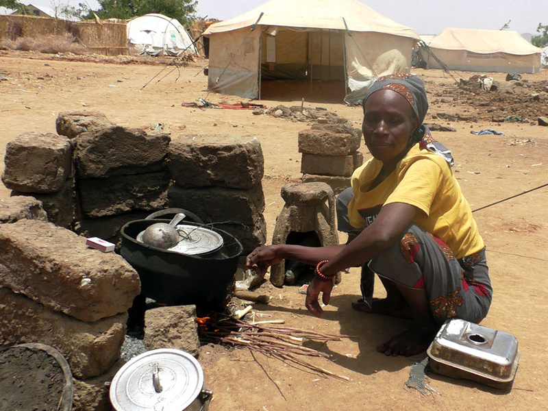 woman cooking in cameroon