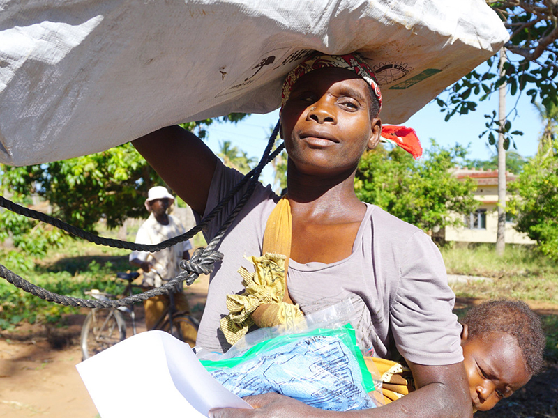 Woman carrying aid on her head in Mozambique