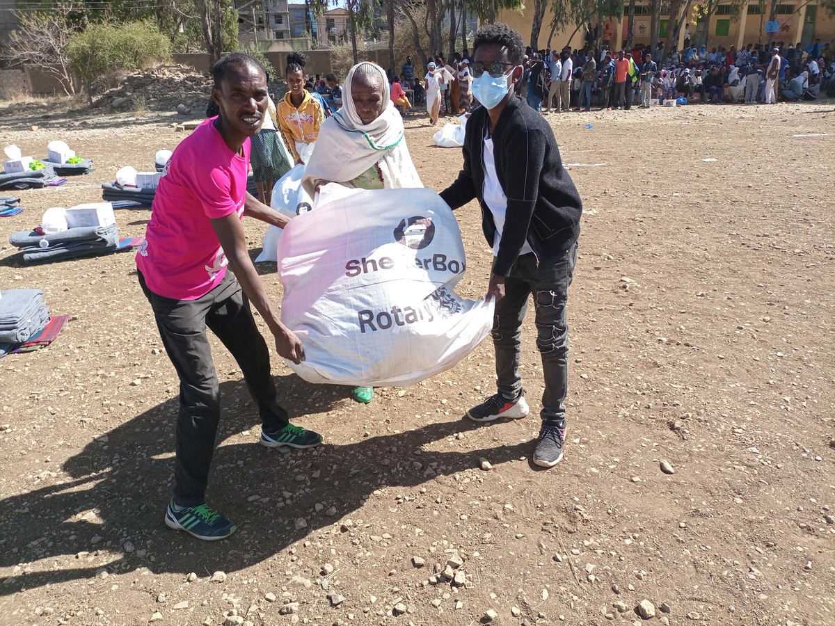 people holding a bag with aid