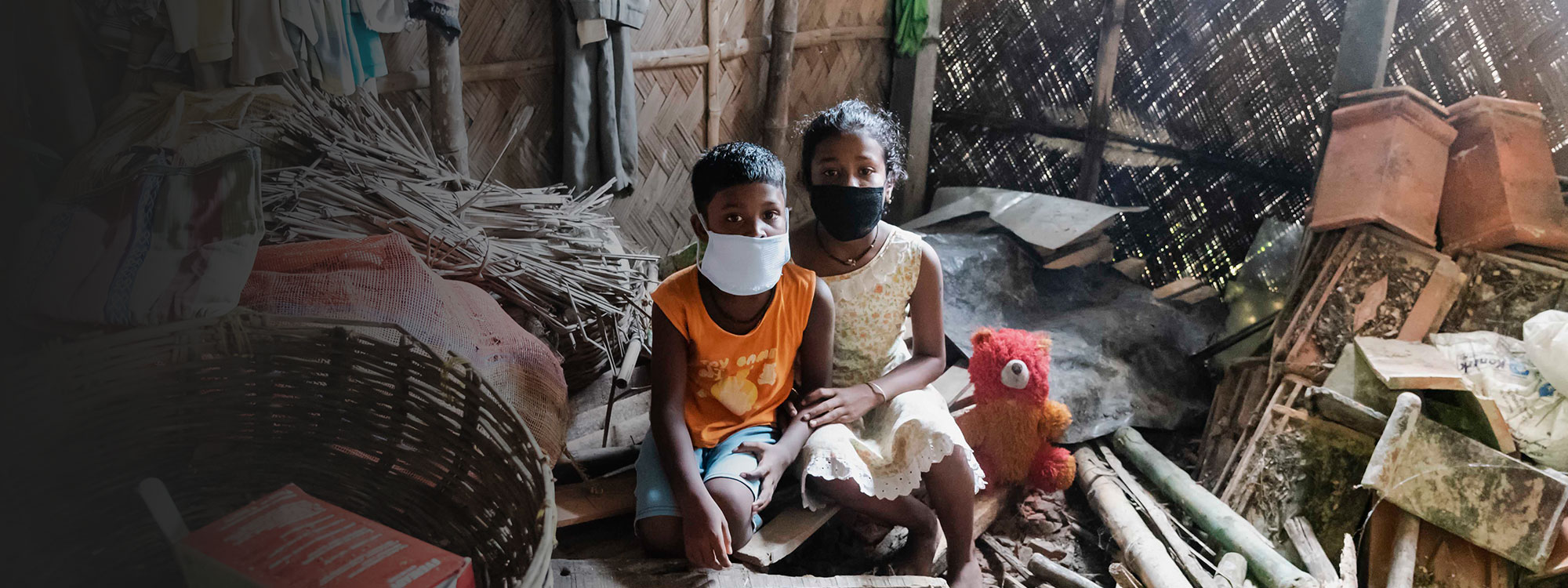 boy and girl hugging in destroyed home