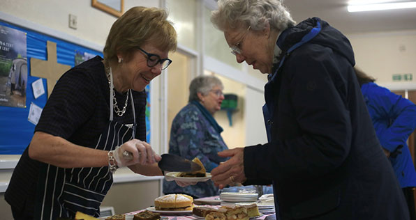 two women at charity bake sale